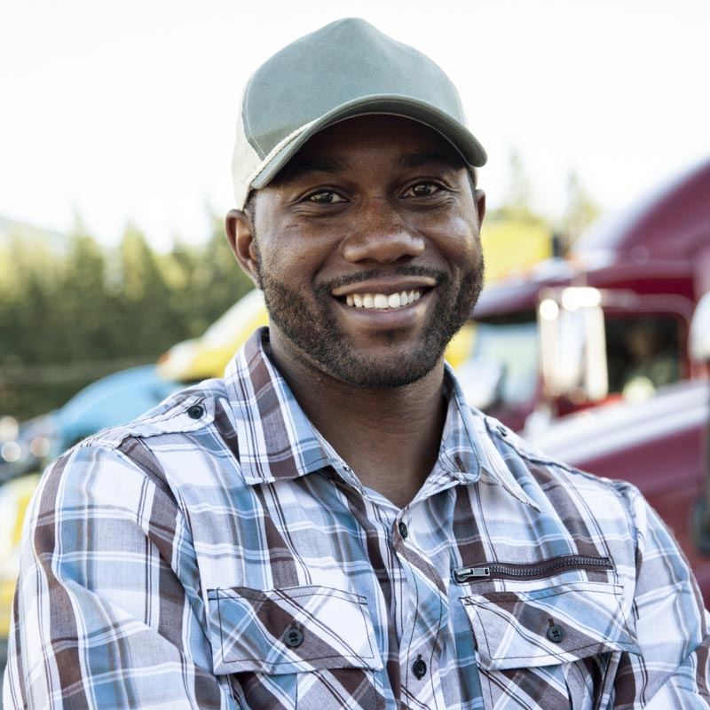African American Truck Driver in a Hat